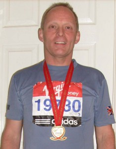A tired Nick with his medal, after his 2010 London Marathon triumph
